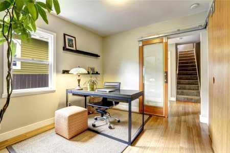 Spacious home office with small desk and chair